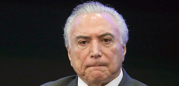 Brazil's President Michel Temer listens in during a event at the Brazilian Institute of Research in Brasilia, Brazil, Monday, May 8, 2017. A year after taking power amid a bitter impeachment battle, the promises by Brazilian President Michel Temer are on hold or lost. (AP Photo/Eraldo Peres) ORG XMIT: ERA303