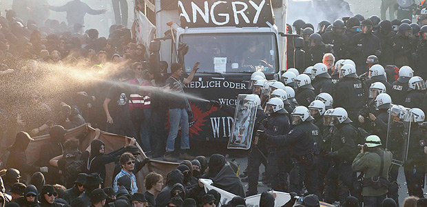 German riot police confront protesters during the demonstrations during the G20 summit in Hamburg, Germany