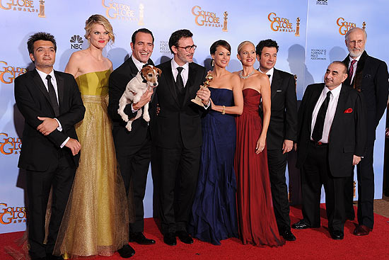 "ORG XMIT: MA284 The Winners for Best Motion Picture - Comedy or Musical ""The Artist"" poses with the trophy at the 69th annual Golden Globe Awards at the Beverly Hilton Hotel in Beverly Hills, California, January 15, 2012. AFP PHOTO / Robyn BECK"