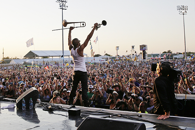 Trombone Shorty reacts to the crowd as he closes out the final set of the 2015 New Orleans Jazz and Heritage Festival in New Orleans, Sunday, May 3, 2015. (AP Photo/Gerald Herbert) ORG XMIT: LAGH121