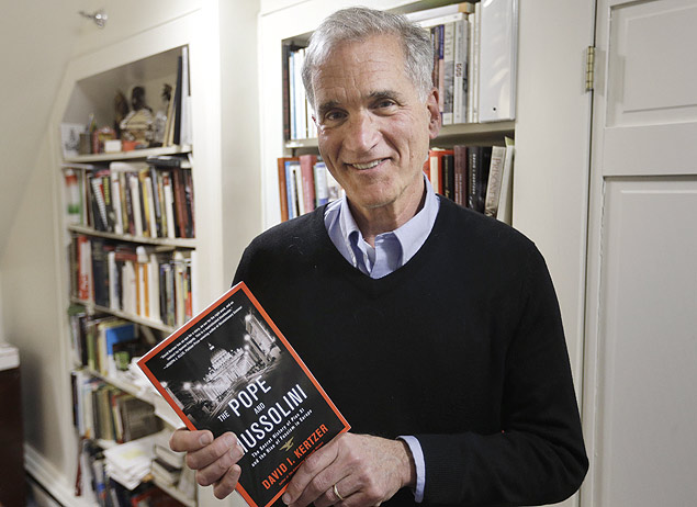 "Brown University professor David I. Kertzer holds his book ""The Pope and Mussolini: The Secret History of Pius XI and the Rise of Fascism in Europe"" in his office, Monday, April 20, 2015, in Providence, R.I. The book won the 2015 Pulitzer Prize for biography-autobiography. (AP Photo/Steven Senne) ORG XMIT: RISR101"