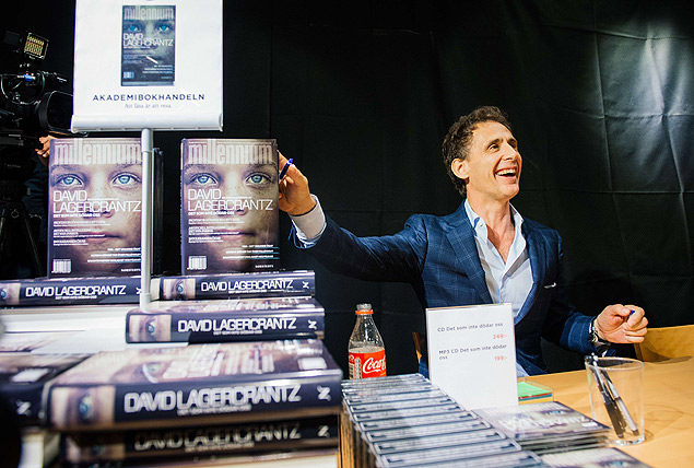 The author of the fourth novel in the Millennium series of crime novels, originally by Stieg Larsson, The Girl in the Spider's Web, Swedish journalist and best-selling author, David Lagercrantz, signs the books for first buyers during a midnight sell on August 27, 2015 at a local book store in Stockholm. AFP PHOTO/JONATHAN NACKSTRAND ORG XMIT: JNK07