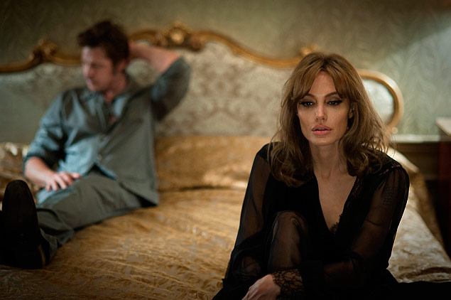 "This photo provided by Universal Pictures shows, Brad Pitt, left, as Roland and Angelina Jolie Pitt as Vanessa in a scene from the film ""By the Sea,"" directed by Jolie Pitt. The movie opens in U.S. theaters on Nov. 13, 2015. (Merrick Morton/Universal Pictures via AP) ORG XMIT: CAET928"
