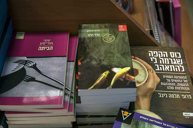"""The book """"Borderlife"""" by Dorit Rabinyan, center, is on display at a bookstore in Ashkelon, Israel, Thursday, Dec. 31, 2015. Israel's Education Ministry has rejected a request by teachers to include the novel about a love affair between a Jewish woman and a Palestinian man in the high school curriculum, reportedly over concerns that it could encourage intermarriage between Jews and non-Jews. (AP/Tsafrir Abayov) ORG XMIT: DV102"""