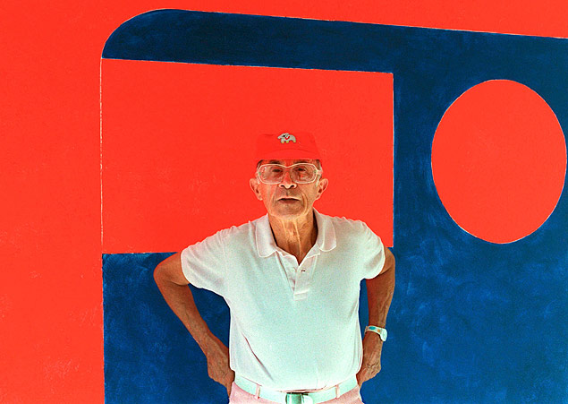 French fashion designer Andre Courreges stands near one of his paintings in the gallery space above his fashion workshops at the Univers Courreges, in this picture taken October 2, 1997, in Paris, France. Courreges, a French fashion designer known for his futuristic designs, died, aged 92, on Thursday January 7, 2016 French media reported today. Picture taken October 2, 1997. REUTERS/John Schults/Files ORG XMIT: JES102