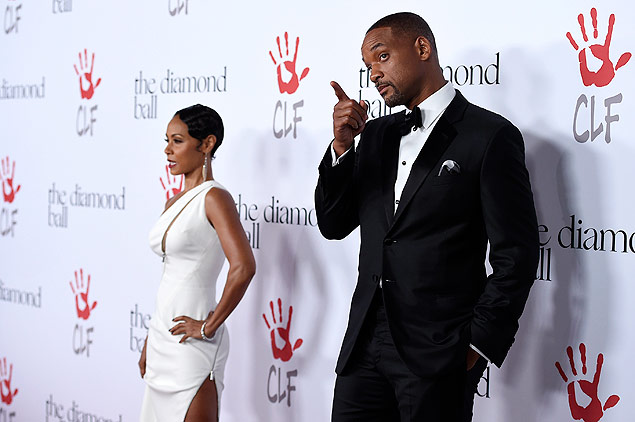 Will Smith, right, and Jada Pinkett Smith attend the 2nd Annual Diamond Ball at The Barker Hangar on Thursday, Dec. 10, 2015, in Santa Monica, Calif. (Photo by Jordan Strauss/Invision/AP) ORG XMIT: CAJS130