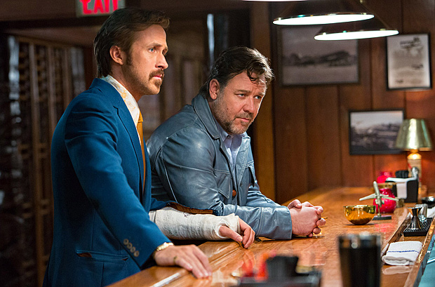 """This image released by Warner Bros. Entertainment shows Ryan Gosling, left, and Russell Crowe in a scene from """"The Nice Guys."""""""