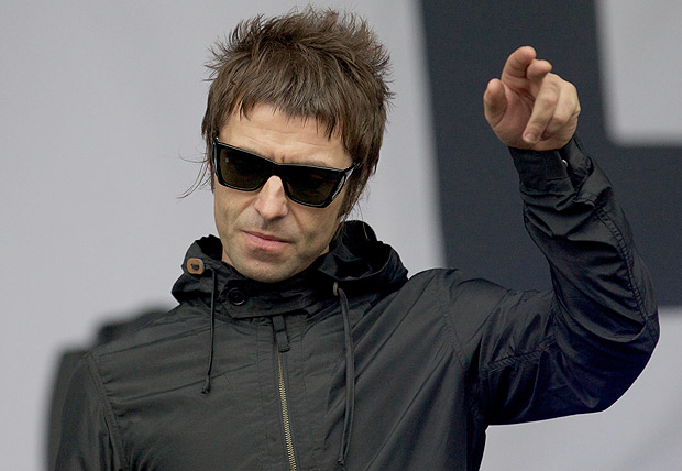 British singer Liam Gallagher gestures to the crowed while performing with his band Beady Eye on third day of the Glastonbury Festival of Contemporary Performing Arts near Glastonbury, southwest England on June 28, 2013. The festival attracts 170,000 party-goers to the dairy farm in Somerset, and this year's tickets sold out within two hours of going on sale. The Rolling Stones will perform at the festival for the first time, headlining on Saturday night. AFP PHOTO/ANDREW COWIE ORG XMIT: 898