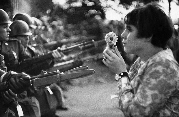 ORG XMIT: 112401_1.tif EMBARGOED UNTIL 00.01 GMT JANUARY 20, 2009. A handout photograph, released to Reuters on January 19, 2009 and shot by veteran French photographer Marc Riboud, shows Jane Rose Kasmir holding a flower up to soldiers during an anti-Vietnam war demonstration outside the Pentagon October 21, 1967. Riboud, whose pictures captured everything from the Vietnam war to everyday scenes of Paris life, has been honoured with a lifetime achievement prize at the Sony World Photography Awards. REUTERS/Marc Riboud/Handout via Sony World Photography Awards (UNITED STATES) ONLY FOR USE WITH ACCOMPANYING ARTS-PHOTOGRAPHY/AWARD STORY TEMPLATE OUT. NO SALES. NO ARCHIVES. FOR EDITORIAL USE ONLY. NOT FOR SALE FOR MARKETING OR ADVERTISING CAMPAIGNS.