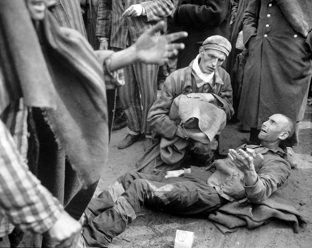 At the German concentration camp at Wobbelin, many inmates were found by the U.S. Ninth Army in pitiful condition. Here one of them breaks out in tears when he finds he is not leaving with the first group to the hospital.