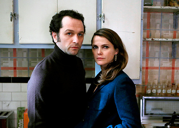 "In this image released by FX, Matthew Rhys, left, and Keri Russell appear in a scene from ""The Americans."" On Thursday, July 14, 2016, Rhys was nominated for outstanding actor in a drama series for his role in the series. The 68th Primetime Emmy Awards will be broadcast live Sunday on ABC beginning at 8 p.m. ET on ABC. (Craig Blankenhorn/FX via AP) ORG XMIT: NYET239"