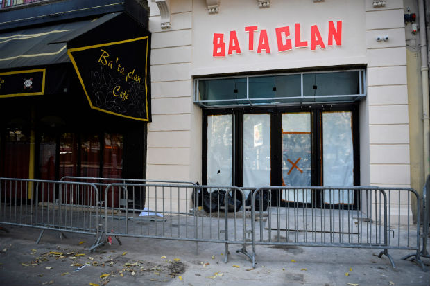 "(FILES) This file photo taken on October 27, 2016 in Paris shows new lettering (R) on the facade of the ""Bataclan"" concert hall, one of the targets of the November 13, 2015 terrorist attacks during which 130 people were killed and another 413 were wounded. British rock star Sting will re-open Paris' Bataclan concert hall on November 12, a day before the anniversary of the jihadist attacks that left 90 people dead there, the venue's owner said on November 4, 2016. The former frontman of The Police confirmed the announcement by Lagardere Unlimited Live Entertainment, saying in a statement on his website: ""In re-opening the Bataclan, we have two important tasks to reconcile. ""First, to remember and honour those who lost their lives in the attack a year ago, and second to celebrate the life and the music that this historic theatre represents."" / AFP PHOTO / MARTIN BUREAU ORG XMIT: MAB11323"