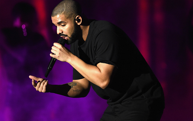 """(FILES) This file photo taken on September 22, 2016 shows recording artist Drake as he performs onstage at the 2016 iHeartRadio Music Festival at T-Mobile Arena in Las Vegas, Nevada. Drake, the rapper who has dominated the charts with his latest album, celebrated his 30th birthday on October 24, 2016 by announcing a new release that includes a song dissing a critic. The Toronto rapper said he would release """"More Life"""" in December and described it as a """"playlist"""" of original music. / AFP PHOTO / GETTY IMAGES NORTH AMERICA / KEVIN WINTER"""