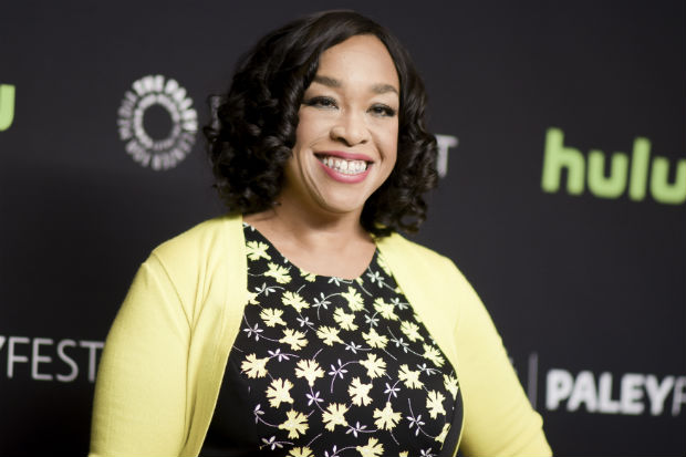 """FILE - In this March 15, 2016 file photo, Shonda Rhimes attends the 33rd Annual Paleyfest: """"Scandal"""" event in Los Angeles. """"Scandal"""" star Tony Goldwyn, who plays President Fitzgerald Grant in the ABC TV drama, will be presenting the honorary International Emmy Founders Award to Rhimes on Monday, Nov. 21, 2016, at the International Emmy Awards Gala at the Hilton in New York. (Photo by Richard Shotwell/Invision/AP, File) ORG XMIT: NY114"""