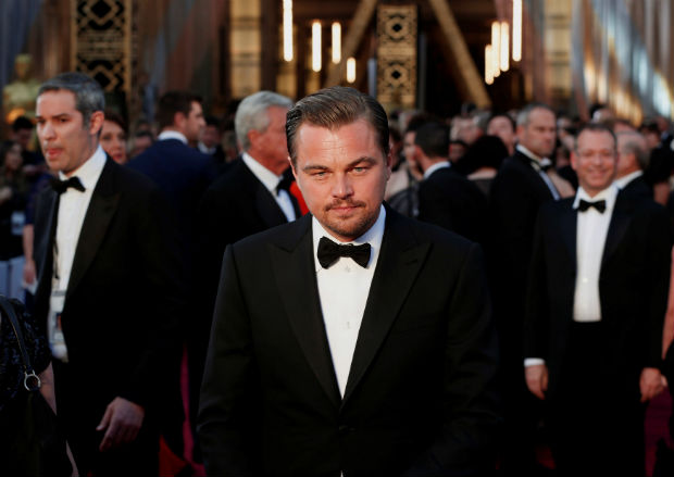 FILE PHOTO - Leonardo DiCaprio, nominated for Best Actor for his role in 'The Revenant', wearing a Giorgio Armani tuxedo, arrives at the 88th Academy Awards in Hollywood, California February 28, 2016. REUTERS/Lucas Jackson/File Photo REUTERS PICTURES OF THE YEAR 2016 - SEARCH 'POY 2016' TO FIND ALL IMAGES ORG XMIT: POY001