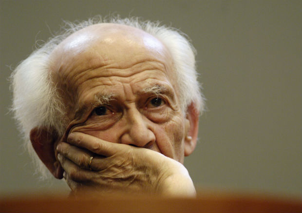 ORG XMIT: 363701_1.tif Zygmunt Bauman, a Polish-born sociologist living in Britain, listens to the opening speech before receiving the Vision 97 Prize from former Czech president Vaclav Havel at a ceremony in Prague Thursday, Oct. 5, 2006. The Vision 97 Foundation, established by President Havel and his wife Dagmar, awards an annual prize that is given to outstanding scientists and thinkers whose work has significantly helped to broaden peoples' horizons while addressing the fundamental questions of human existence. (AP Photo/CTK, Michal Kamaryt) ** SLOVAKIA OUT **