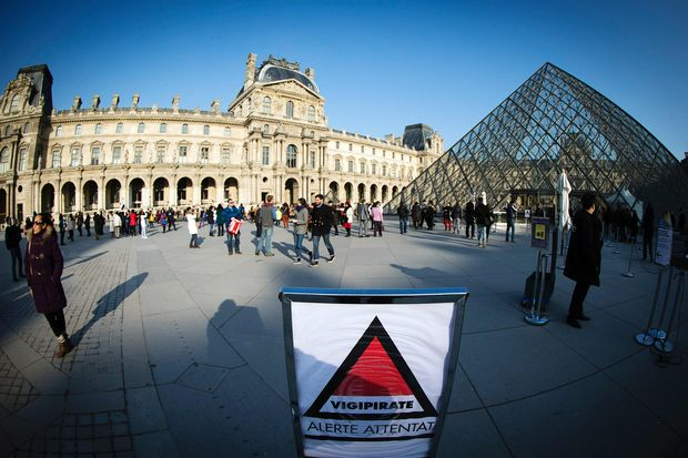 "(FILES) This file photo taken on February 12, 2015 shows A sign shows the symbol of France's national security alert system ""Vigipirate"", set at the highest ""Attack alert"" level, near the Louvre Pyramid in central Paris on February 12, 2015. AFP PHOTO / JOEL SAGET Taking place in a time when the risk of terrorim is considered very high, in the wake of several terror attacks in the last two years, the 2017 French presidential elections will be held under a state of emergency, an unprecedented situation under the Fifth Republic. / AFP PHOTO / JOEL SAGET ORG XMIT: 7266"