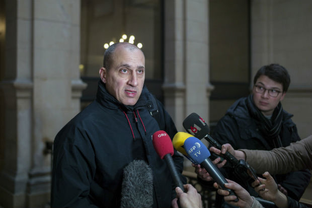 Chief suspect Vjeran Tomic faces the media at court for his trial in Paris, Monday Feb. 20, 2017, accused of involvement in one of the world's biggest art heists. Three people, including Vieran are accused of being involved in a dramatic 2010 theft of more than $100 million worth of artworks from the Paris Museum of Modern Art, including a Picasso, a Matisse and other masterpieces. (AP Photo/Thibault Camus) ORG XMIT: XTC105
