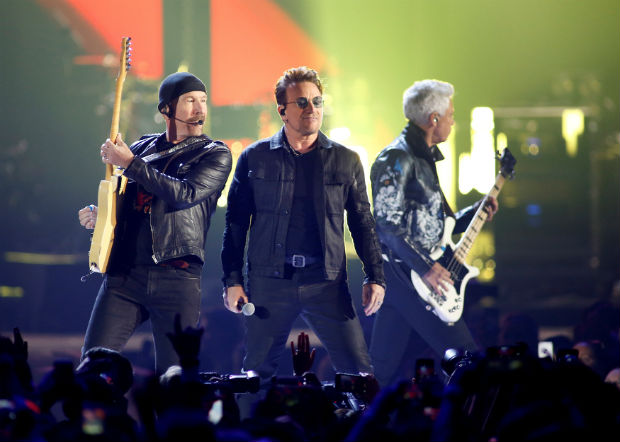Bono (C), guitarist The Edge (L) and bass guitarist Adam Clayton of U2 perform during the iHeartRadio Music Festival at The T-Mobile Arena in Las Vegas, Nevada, U.S. on September 23, 2016. REUTERS/Steve Marcus/File Photo ORG XMIT: TOR322