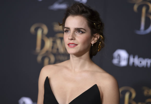 "FILE - In this March 2, 2017, file photo, Emma Watson arrives at the world premiere of ""Beauty and the Beast"" at the El Capitan Theatre in Los Angeles. Watson told The Associated Press on March 4, 2017, that critics who claimed her recent photoshoot for Vanity Fair betrayed her feminist ideals have ""a fundamental and complete misunderstanding of what feminism is."" (Photo by Jordan Strauss/Invision/AP, File) ORG XMIT: PAPM105"