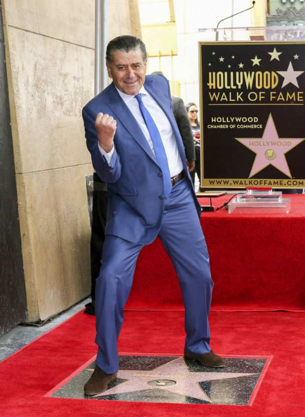 """Haim Saban, creator of the """"Power Rangers,"""" poses at a ceremony honoring him with a star on the Hollywood Walk of Fame on Wednesday, March 22, 2017, in Los Angeles. (Photo by Willy Sanjuan/Invision/AP) ORG XMIT: CAWS108"""