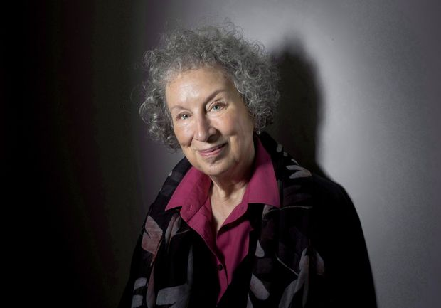 """FILE - In this June 9, 2015 file photo, author Margaret Atwood poses to promote her novel, """"The Heart Goes Last"""" in Toronto. Atwood, marvels at how her 1985 novel, """"The Handmaid's Tale,"""" has not only been given renewed life as a TV series but has also gained disturbing urgency. (Darren Calabrese/The Canadian Press via AP, File) ORG XMIT: NYET450"""