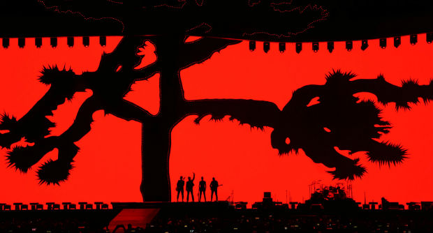 Members of the band U2 kick off their world tour of the Joshua Tree in Vancouver, British Columbia, Canada Friday, May 12, 2017. (Jonathan Hayward/The Canadian Press via AP) ORG XMIT: JOHV101