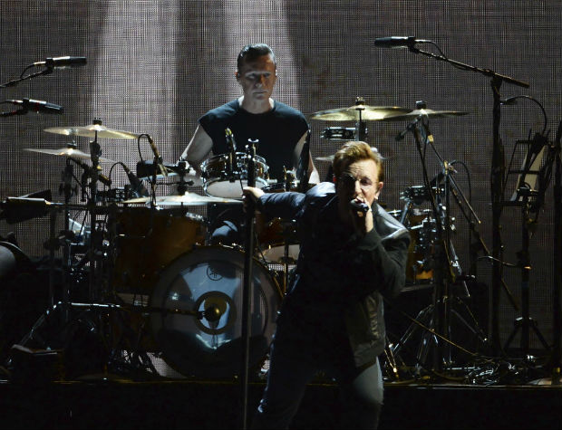 "Members of U2 perform during their world tour celebrating the 30-year anniversary of their ""Joshua Tree"" album in Vancouver, British Columbia, Friday, May 12, 2017. (Jonathan Hayward/The Canadian Press via AP) ORG XMIT: JOHV502"
