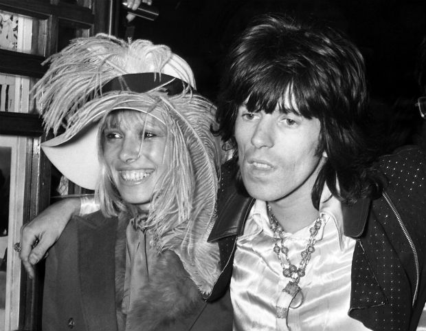 """FILE - In this July 17, 1968 file photo, Keith Richards from the Rolling Stones, right, arrives at the premiere of the new Beatles cartoon film """"Yellow Submarine"""" with Anita Pallenberg in London. Pallenberg, a model and actress who had children with Keith Richards and served as a muse for The Rolling Stones, died Tuesday, June 13, 2017 at St Richard's Hospital in the city of Chichester, located in southeast England.. She was 75. (AP Photo/Peter Kemp, File) ORG XMIT: NYET312"""