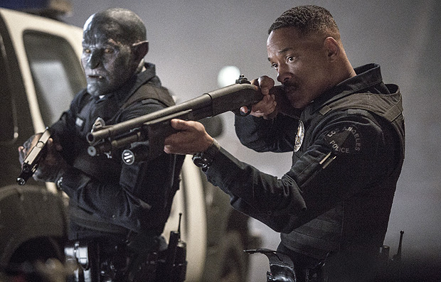 """This image released by Netflix shows Will Smith, right, and Joel Edgerton in a scene from, """"Bright."""" (Matt Kennedy/Netflix via AP) ORG XMIT: NYET654"""