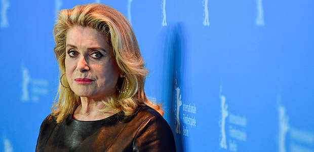 "(FILES) This file photo taken on February 14, 2017 shows French actress Catherine Deneuve posing for photographers during a photocall for the film ""Sage Femme"" (The Midwife) in competition at the 67th Berlinale film festival in Berlin. Feminists and one of the women who accused fallen Hollywood mogul Harvey Weinstein of rape turned on French actress Catherine Deneuve on January 10, 2018 after she signed an open letter attacking the #MeToo movement for leading a witch-hunt against men. / AFP PHOTO / John MACDOUGALL"