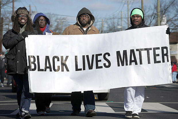 WASHINGTON, DC - JANUARY 18: Members of Black Lives Matter DMV participate in the annual Martin Luther King Holiday Peace Walk and Parade January 18, 2016 in Washington, DC. The nation observes the life and legacy of Martin Luther King Jr. today. Alex Wong/Getty Images/AFP == FOR NEWSPAPERS, INTERNET, TELCOS & TELEVISION USE ONLY ==