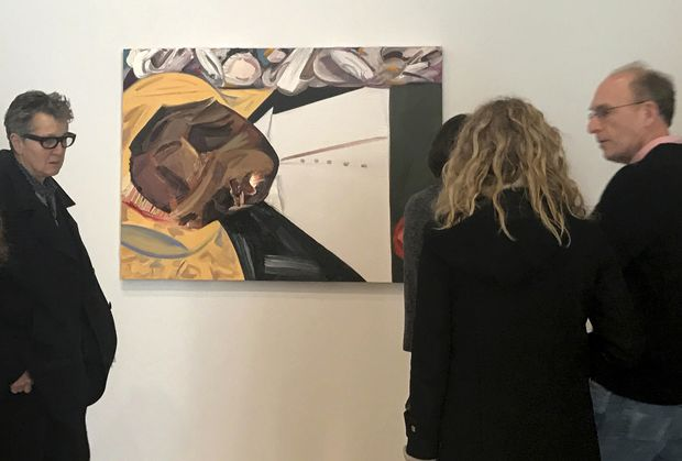 "A group of museum-goers examine a painting entitled ""Open Casket"" by artist Dana Schutz at the Whitney Museum of American Art in New York, Thursday, March 23, 3017. The painting, made with the aid of historical photographs of Emmett Till as he lay in his casket, has left some gravely displeased and triggered outcry. Till was a 14-year-old black teenager when he was killed by white men in 1955 for allegedly whistling at a white woman. (AP Photo/Alina Heineke) ORG XMIT: NYR104"