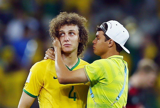 Brazil's David Luiz (L) is consoled by teammate Thiago Silva after their loss to Germany