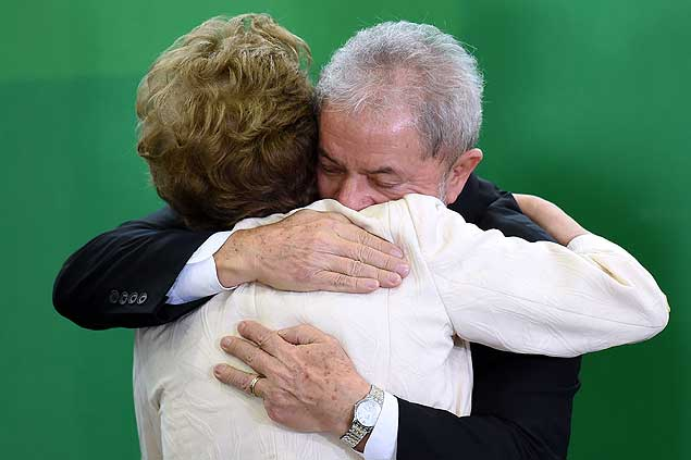 Former Brazilian president Luiz Inacio Lula da Silva hugs Brazilian president Dilma Rousseff after he swore as chief of staff in Brasilia on March 17, 2016. Rousseff appointed Lula da Silva as her chief of staff hoping that his political prowess can save her administration. The president is battling an impeachment attempt, a deep recession, and the fallout of an explosive corruption scandal at state oil giant Petrobras. AFP PHOTO/EVARISTO SA EVARISTO SA / AFP ORG XMIT: ESA226