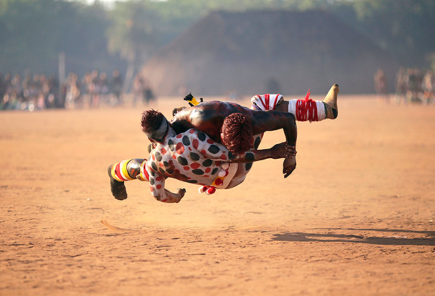 Waura Indians wrestle during this year's 'quarup,' a ritual held over several days to honour in death a person of great importance to them, in Xingu National Park, Mato Grosso State