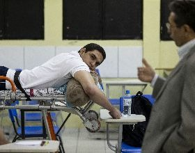 Wounded and with a Bullet in His Back, Brazilian Medicine Student Attends Classes in Hospital Bed