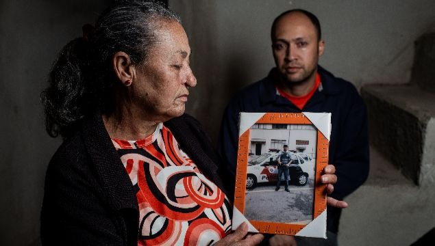 Gedalva Maria dos Santos, 66, with the photo of her son Osmar Santos Ferreira. Osmar was assassinated on June 22, 2012