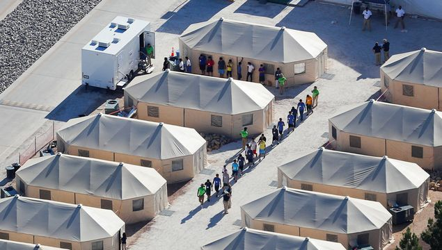 "Immigrant children now housed in a tent encampment under the new ""zero tolerance"" policy by the Trump administration are shown walking in single file at the facility near the Mexican border in Tornillo, Texas, U.S."