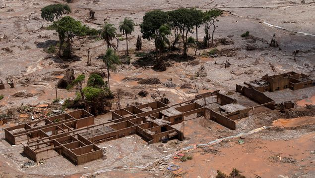 FILE PHOTO: The debris of the municipal school of Bento Rodrigues district, which was covered with mud after a dam owned by Vale SA and BHP Billiton Ltd burst, is pictured in Mariana, Brazil, November 10, 2015