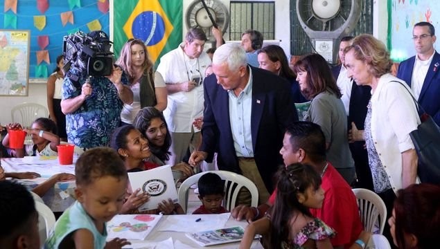 US Vice President Mike Pence speaks with Venezuelan refugees at the Santa Catarina Humanitarian Centre in Manaus, on June 27, 2018