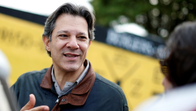 Former Sao Paulo mayor Fernando Haddad leaves the Federal Police headquarters, where Brazilian former President Luiz Inacio Lula da Silva is imprisoned, after visiting him, in Curitiba