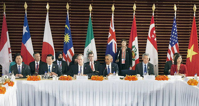 FILE - In this Nov. 10, 2014 file photo, U.S. President Barack Obama, center, speaks during his meeting with leaders of the Trans-Pacific Partnership countries, in Beijing. Sitting with Obama are, from left, Vietnam Minister of Industry and Trade Vu Hoy Hoang, Vietnam Prime Minister Nguyen Tan Dung, U.S. Trade Representative Ambassador Mike Froman, Singapore Prime Minister Lee Hsien Loong, and Singapore Sec. of Ministry of Trade and Industry Ow Foong Pheng. The United States and 11 other Pacific Rim countries on Monday, Oct. 5, 2015, agreed to the Trans-Pacific Partnership, an ambitious and controversial trade pact that cuts trade barriers, sets labor and environmental standards and protects multinational corporations' intellectual property. (AP Photo/Pablo Martinez Monsivais, File) ORG XMIT: NYBZ141