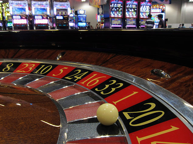 "ORG XMIT: MAC10 A ball is seen on a roulette wheel in front of slot machines at Gaming Expo Asia in Macau in this May 22, 2012 file photo. Chinese authorities are pressing Macau to step up scrutiny of money transfers as part of a broader move to combat corruption and promote ""responsible gaming"" in the casino halls of the world's largest gambling hub. REUTERS/Bobby Yip/Files (CHINA - Tags: BUSINESS SOCIETY CRIME LAW POLITICS)"