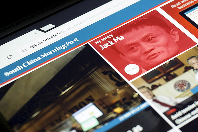 The South China Morning Post website and an image of Jack Ma, founder and executive chairman of Alibaba Group Holding Ltd, are displayed on a computer in Hong Kong, China, in this November 23, 2015 file photo illustration. Chinese e-commerce giant Alibaba Group Holding Ltd said it would buy publisher SCMP Group Ltd's media assets, including the South China Morning Post newspaper. The deal also includes licenses to several publications, including Hong Kong editions of Elle, Cosmopolitan and Harper's Bazaar. Financial terms of the deal were not disclosed. REUTERS/Tyrone Siu/Files EDITORIAL USE ONLY. NO RESALES. NO ARCHIVE ORG XMIT: TS02