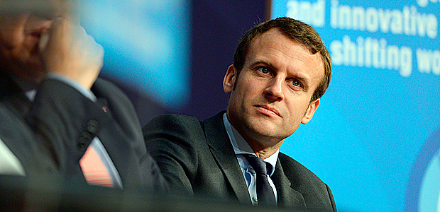 French Economy Minister Emmanuel Macron listens during the international economic forum Latin America and the Caribbean at the economy ministry in Paris on June 3, 2016 / AFP PHOTO / ERIC PIERMONT ORG XMIT: EP5291