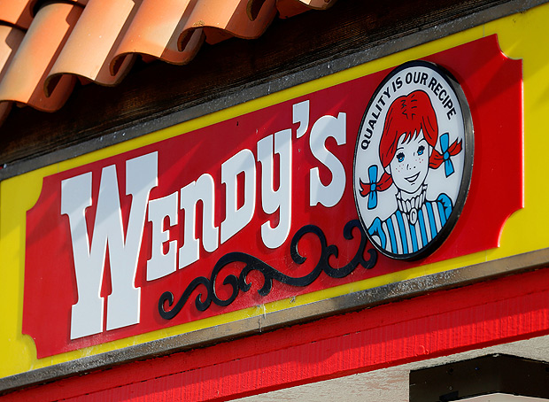 A Wendy's sign and logo are shown at one of the company's restaurant in Encinitas, California May 10, 2016. REUTERS/Mike Blake ORG XMIT: MB101
