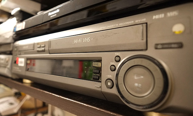 This picture shows a VHS videocassette recorder in Tokyo on July 22, 2016. The world's last videocassette recorder is set to roll off the factory line as a Japanese manufacturer ends production of the once booming home-theatre technology. Funai Electric, which says it is the world's last VCR manufacturer, pointed to a sharp decline in demand and trouble sourcing parts. / AFP PHOTO / KAZUHIRO NOGI ORG XMIT: KN220