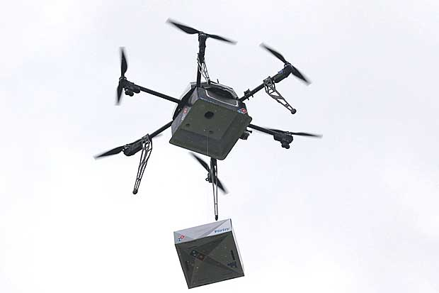 A delivery drone performs a test flight with a Domino's pizza box in Auckland, New Zealand, August 25, 2016.