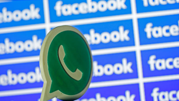 A 3D printed Whatsapp logo is seen in front of a displayed Facebook logo in this illustration taken April 28, 2016. REUTERS/Dado Ruvic/Illustration ORG XMIT: DAD07